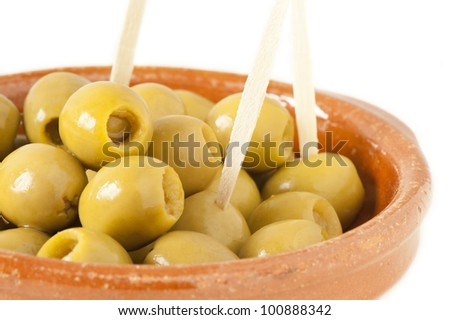 Olives filled with anchovy over white background - stock photo