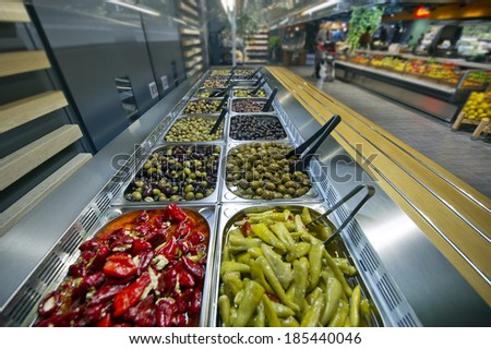 olives for sale at the market - stock photo
