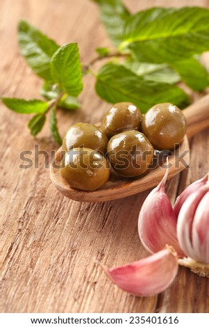Olives, garlic and mint - stock photo