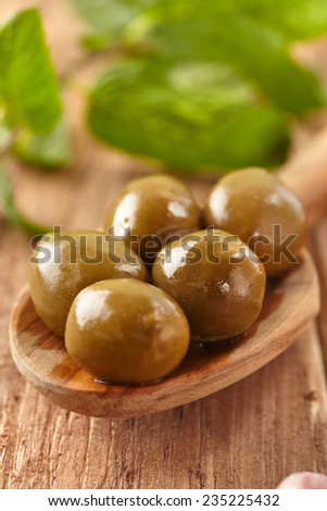 Olives, garlic, chili peppers and mint - stock photo