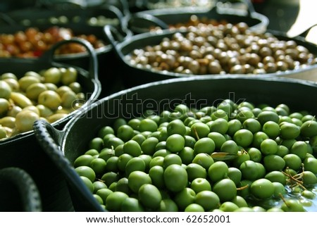 olives in pickling brine pattern background texture in market - stock photo