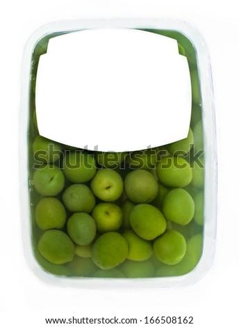 olives in plastic box surface isolated on white background. white label