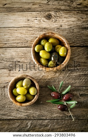 olives on old wood. Wooden table with olives and olive oil - stock photo