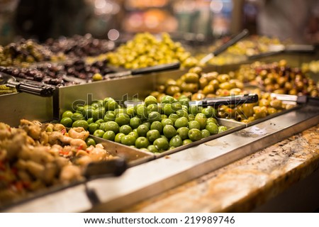 Olives on sale/display in a food market/grocery store - stock photo