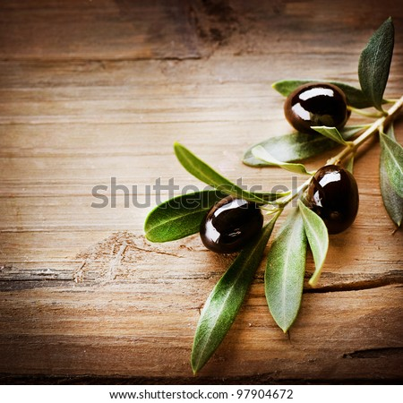 Olives over Wooden Background - stock photo
