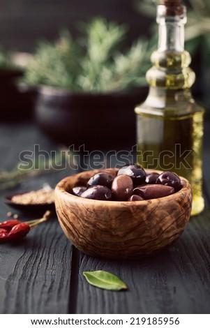 Olives with herbs. Mediterranean ingredients: rosemary, olives, thyme, sage, salt, oregano - stock photo