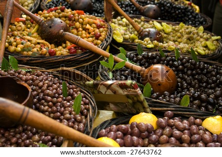 Olives with serving spoons - stock photo