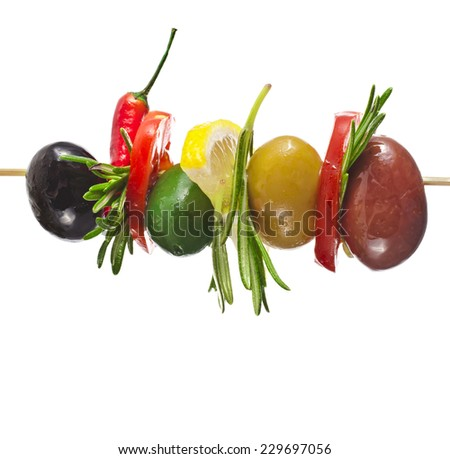 olives with vegetables, herbs, spices in wooden stick isolated on a white background - stock photo