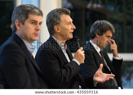 Olivos, Argentina - May 6, 2016: President of Argentina Mauricio Macri (C), Finance Minister Alfonso Prat-Gay (R) and Cabinet Chief Marcos Pena during a press conference at the presidential residence