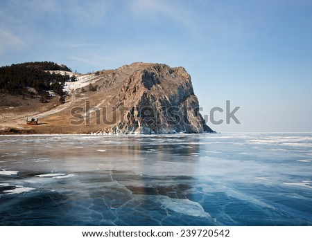 Olkhon - the heart of Lake Baikal, rocky shores and clear ice - stock photo