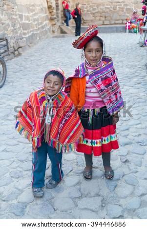 Ollantaytambo, Peru - circa June 2015: Children in traditional Peruvian clothes in Ollantaytambo, Peru - stock photo