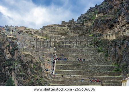 Ollantaytambo, Peru - July 16, 2013: tourists at Ollantaytambo, Incas ruins in the peruvian Andes at Cuzco Peru on July 16 2013 - stock photo