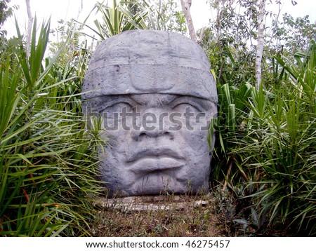 olmec head in cozumel, mexico - stock photo
