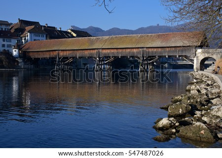 Olten, Solothurn, Switzerland - December 29, 2016: Wooden foot bridge across the Aare River to the old city