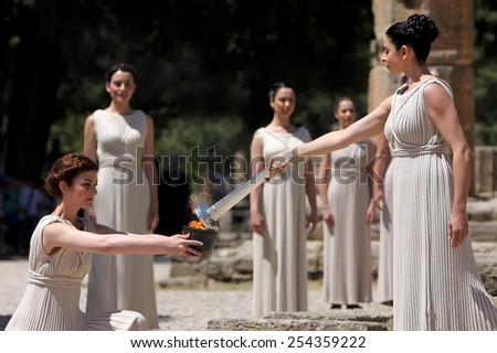 OLYMPIA , GREECE, MAY 9, 2012: High Priestess, the Olympic flame during the Torch lighting ceremony of the Olympic Games in London in 2012 at ancient Olympia - stock photo
