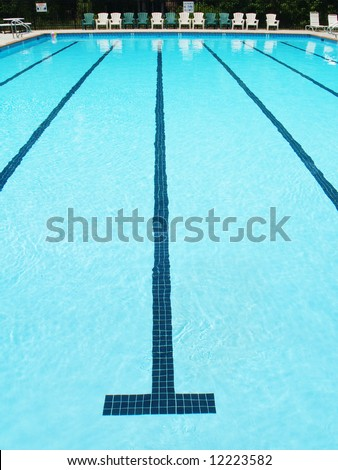 Olympic sized swimming pool lane with stripe on the bottom stock photo for A swimming pool is 50m long and 20m wide