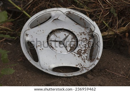 OLYMPOS, TURKEY - OCTOBER 14, 2009: Broken Hubcap of a Mercedes in mud after flood disaster in Olympus, Turkey. - stock photo