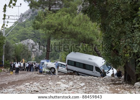 OLYMPOS, TURKEY - OCTOBER 14: Crashed cars and worried people after flood disaster on October 14, 2009 in Olympos, Turkey, Asia. - stock photo