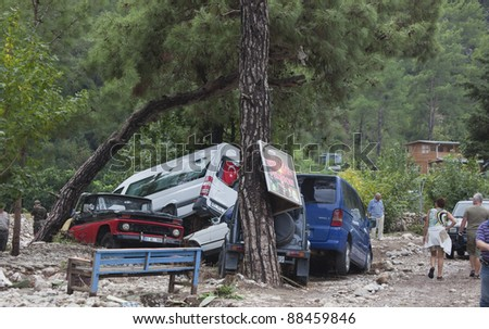 OLYMPOS, TURKEY - OCTOBER 14: Crashed cars in the woods after flood disaster on October 14, 2009 in Olympos, Turkey, Asia. The floods destroyed roads and houses and swept away about 50 cars. - stock photo