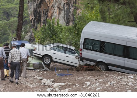 OLYMPOS, TURKEY - OCTOBER 14: Olympos, a famous holiday spot was hit by floods on October 14, 2009, Olympos, Turkey. The floods swept away about 50 cars parked on the road. Roads, bridges and houses were destroyed. - stock photo