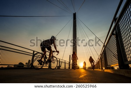 OMAHA, NE - A family bicycles across the Bob Kerry Pedestrian Bridge from Council Bluffs, IA to Omaha, NE August 18, 2013.  - stock photo