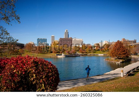 OMAHA, NE - Joggers were out in force on a warm December day in Heartland of America Park December 9, 2013 in Omaha Nebraska. - stock photo