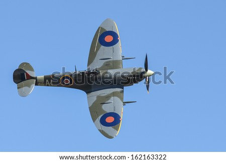 """OMAKA-APRIL 03:Supermarine Spitfire aircraft in flight during the royal New Zealand air force """"Omaka airshow"""" on April 03, 2013 in Blenheim New Zealand - stock photo"""