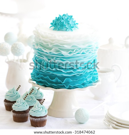 Ombre ruffle cake on a dessert table - stock photo