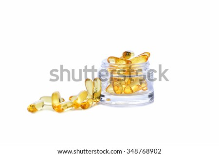 Omega 3 capsules for the concept of fasting in a glass cup on a white background. - stock photo
