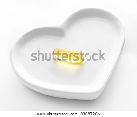 Omega-3 pills on a white hearth. - stock photo
