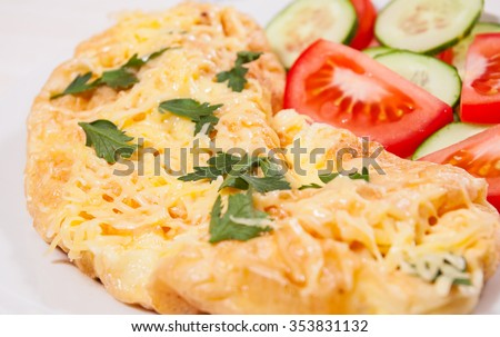 Omelet with cheese and vegetables - stock photo