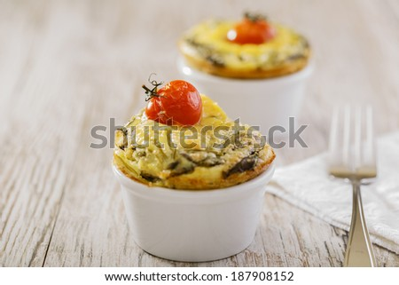 omelet with spinach cherry tomatoes - stock photo