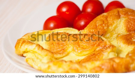 omelette with tomato - stock photo