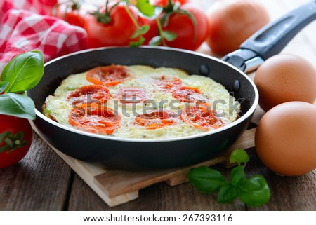 Omelette with tomatoes - stock photo