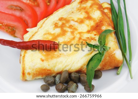 omelette with tomatoes and pepper served on white plate isolated on white background - stock photo