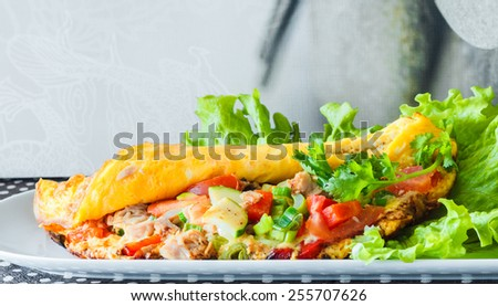Omelette with vegetable and tuna - stock photo