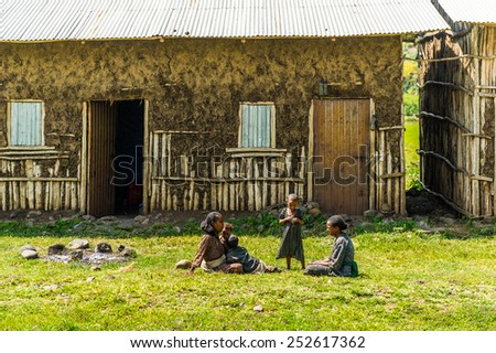 OMO, ETHIOPIA - SEPTEMBER 19, 2011: Unidentified Ethiopian children near their house. People in Ethiopia suffer of poverty due to the unstable situation