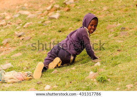 OMO, ETHIOPIA - SEPTEMBER 21, 2011: Unidentified Ethiopian man on the grass. People in Ethiopia suffer of poverty due to the unstable situation