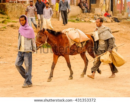 OMO, ETHIOPIA - SEPTEMBER 21, 2011: Unidentified Ethiopian man walks with a horse outdoors. People in Ethiopia suffer of poverty due to the unstable situation