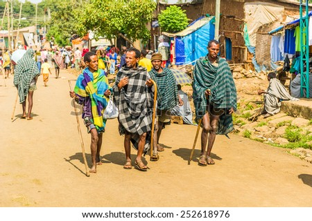 OMO, ETHIOPIA - SEPTEMBER 19, 2011: Unidentified Ethiopian men with bastons in the street. People in Ethiopia suffer of poverty due to the unstable situation