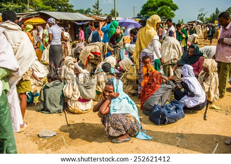OMO, ETHIOPIA - SEPTEMBER 19, 2011: Unidentified Ethiopian people and children at the local market. People in Ethiopia suffer of poverty due to the unstable situation