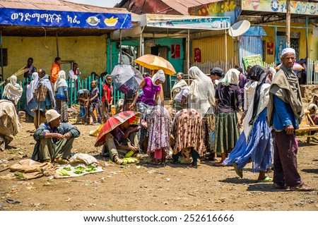 OMO, ETHIOPIA - SEPTEMBER 21, 2011: Unidentified Ethiopian people at the local market. People in Ethiopia suffer of poverty due to the unstable situation