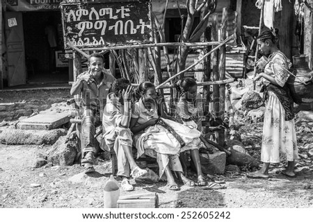 OMO, ETHIOPIA - SEPTEMBER 19, 2011: Unidentified Ethiopian people in the street. People in Ethiopia suffer of poverty due to the unstable situation