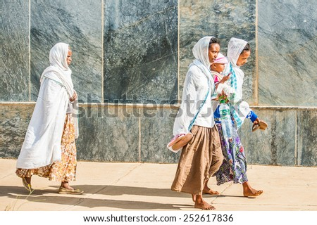 OMO, ETHIOPIA - SEPTEMBER 21, 2011: Unidentified Ethiopian women in a white tissues in the street. People in Ethiopia suffer of poverty due to the unstable situation