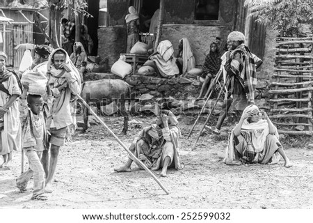 OMO, ETHIOPIA - SEPTEMBER 19, 2011: Unidentified Ethiopian women sit on the ground. People in Ethiopia suffer of poverty due to the unstable situation