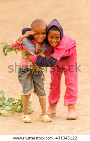 OMO, ETHIOPIA - SEPTEMBER 21, 2011: Unidentified Ethiopiangirl and boy smile. People in Ethiopia suffer of poverty due to the unstable situation