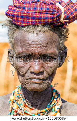 OMO VALLEY, ETHIOPIA - AUG 15: Erbore elder posing in the village,the ethnic groups in the The Omo valley Could disappear Because of Gibe III hydroelectric dam. on Aug 15, 2011 in Omo Valley, Ethiopia. - stock photo