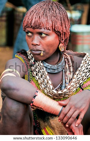 OMO VALLEY, ETHIOPIA - AUG 15: Hamer women in the Turmi market, the ethnic groups in the Omo valley could disappear because of Gibe III hydroelectric dam on Aug 15, 2011 in Omo Valley, Ethiopia. - stock photo