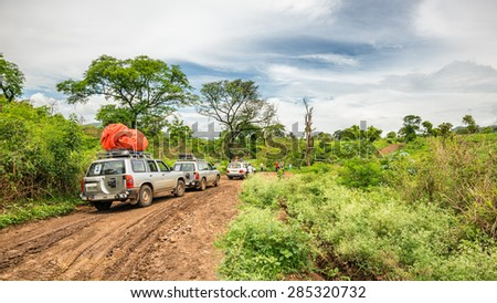OMO VALLEY, ETHIOPIA - MAY 3, 2015 : SUV cars on an expedition in the rainforest of southern Ethiopia - stock photo