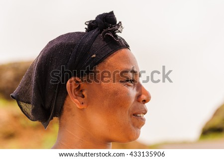 OMO VALLEY, ETHIOPIA - SEP 19, 2011: Portrait of an unidentified Ethiopian woman in a black hat in Ethiopia, Sep.19, 2011. People in Ethiopia suffer of poverty due to the unstable situation